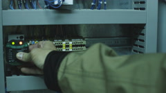 Man doing electrical metering equipment Stock Footage