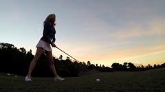 A woman playing golf. Stock Footage