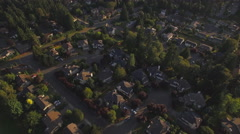 Sunset Aerial of Suburban Houses with Great View of City in the Distance Stock Footage