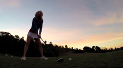 A woman playing golf, slow motion. Stock Footage