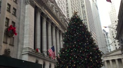 NEW YORK CITY: A Christmas holiday tree stands in front of New York Stock Exchan Stock Footage