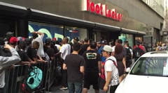 NEW YORK CITY: Kids and adults wait on line at Foot Locker and Stock Footage