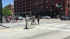DENVER, COLORADO: A man waits at intersection on bike bicycle, Stock Footage
