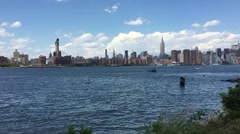 NEW YORK CITY: Shot of Manhattan skyline from park in Williamsburg, Stock Footage