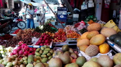 People buy fruit at the market selling fruits Stock Footage