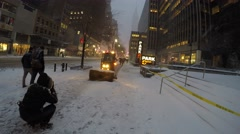 New York City: A sidewalk sweeper cleans the snow off the Stock Footage