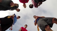 A group of young men playing flag football on the beach, slow motion. Stock Footage