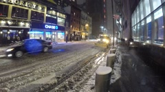 New York City: A sanitation truck removes snow from roads in Stock Footage