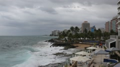 June 2015, San Juan Puerto Rico - the ocean waves roll up to the beach and Stock Footage