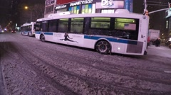 New York City - January 26, 2015: A MTA bus has snow chains on it as it Stock Footage