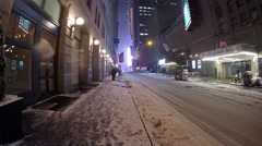 New York City - January 26, 2015: A man shovels snow on Broadway during the Stock Footage