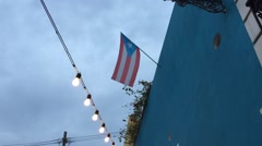Puerto Rico: The Puerto Rican flag hangs on top of a building in Old Stock Footage