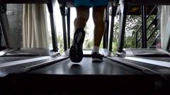 Silhouette of man running on treadmill Stock Footage