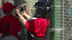 Kids playing little league baseball, slow motion. Stock Footage