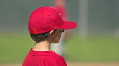 Kids playing little league baseball, slow motion. Stock Footage