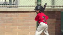 A boy at bat while playing little league baseball, super slow motion. Stock Footage