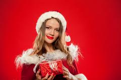 Christmas, x-mas, winter, happiness concept - smiling woman in santa helper hat Stock Photos