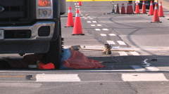 Worker killed in road construction accident Stock Footage