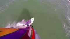 POV bird's-eye view of a man windsurfing. Stock Footage