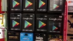 Woman picking twenty five and fifty dollars google play gift cards Stock Footage
