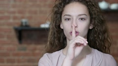 Silent, Young Woman Showing Gesture of Silence Stock Footage
