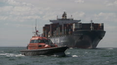 Pilot Boat and Ship exiting port phillip heads Stock Footage