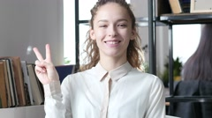 Business Woman Showing Victory Sign, Indoor Office Stock Footage