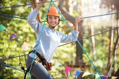 Well built young woman holding on to the ropes Stock Photos
