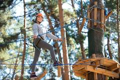 Active cheerful woman approaching the tree Stock Photos