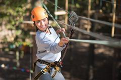 Confident happy woman enjoying adventure climbing Stock Photos