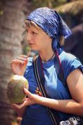 Drinking coconut juice Stock Photos