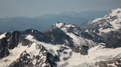 Aerial view glaciers on the mountain tops Stock Footage