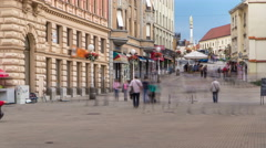 Street with historic buildings in citycentre and Holy Mary monument in front of Stock Footage