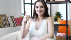 Thumbs Up By Woman, Indoor Stock Footage