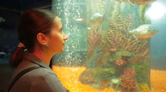 Woman watch Fishes at aquarium Stock Footage