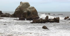 Waves crashing into sea rocks by the beach in Choshi, Chiba Prefecture, Japan Stock Footage