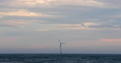 Wind turbine in the sea at sunset on a rainy day, Byobugaura cliff, Chiba Stock Footage