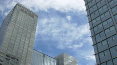 View of business buildings and clouds in the sky, Tokyo, Japan Stock Footage
