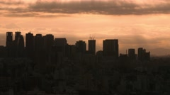 Bird's eye view of the dramatic sky over Tokyo cityscape before sunset, Tokyo, Stock Footage