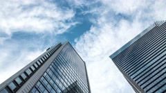 Time-lapse footage of business buildings and clouds in the sky, Tokyo, Japan Stock Footage