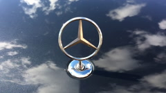 Close up symbol of Mercedes Benz on car Stock Footage