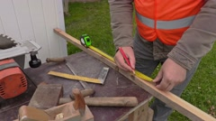 Carpenter using tape measure Stock Footage