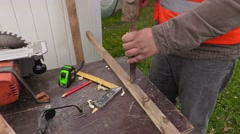 Carpenter with hammer and chisel Stock Footage