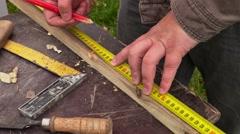Carpenter measured wooden plank Stock Footage