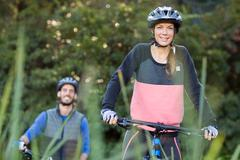 Biker couple cycling in countryside Stock Photos