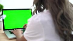 Asian Woman Using A Green Screen Notebook Computer Stock Footage
