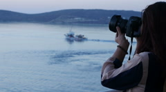 Asian woman photographer taking pictures on a boat 4K Stock Footage