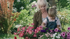 Grandmother Teaching Granddaughter Gardening Stock Footage