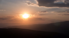 Sunset over the mountains in 4K, timelapse Stock Footage