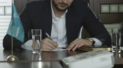 Businessman in an suit signs the contract. Young businessman Stock Footage